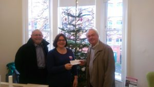 Gerard Boitelle and Richard Blackburn present a cheque for £1060 from Howley Hall