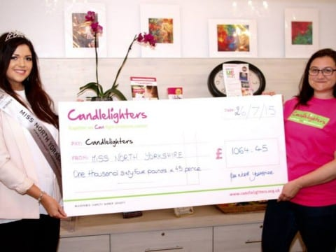 Miss North Yorkshire Anne-Marie O'Donnell presents Events Fundraiser Noemie with the total funds raised by the 2015 competition.
