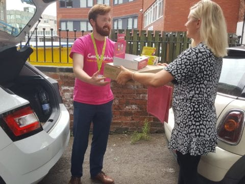 Volunteer Delivery Driver handing delivery to Candlelighters staff from boot of their car